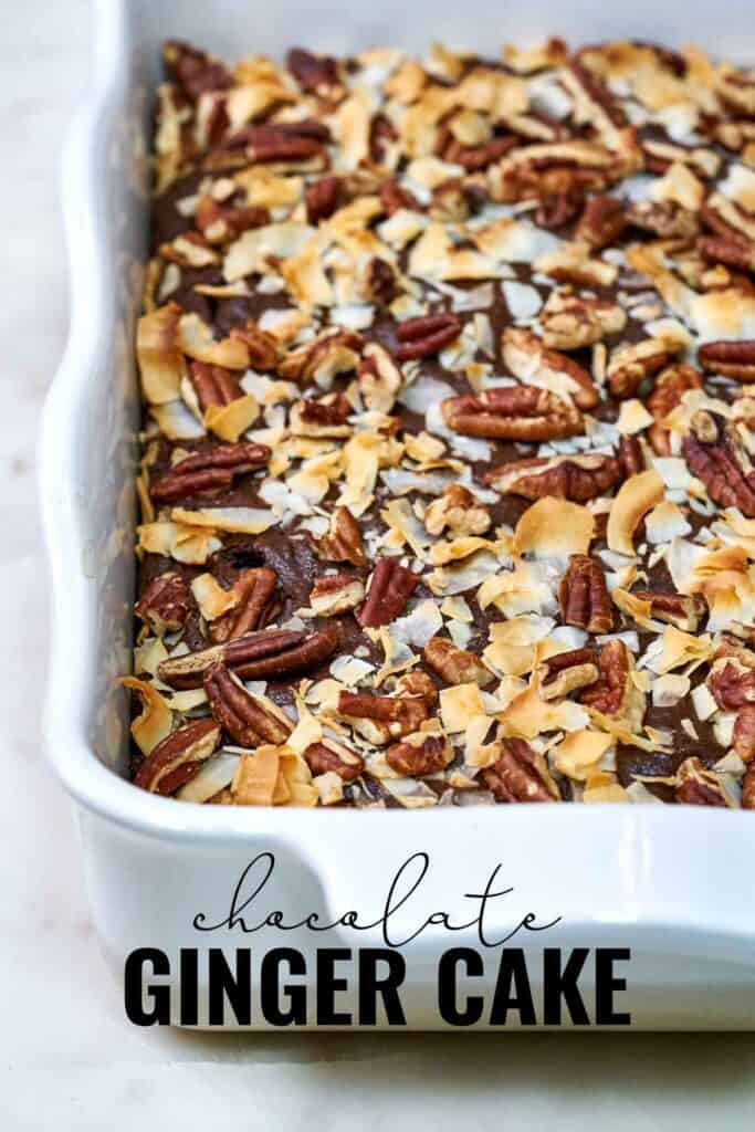 Cake in a white baking dish covered in pecans and coconut after baking with title text.