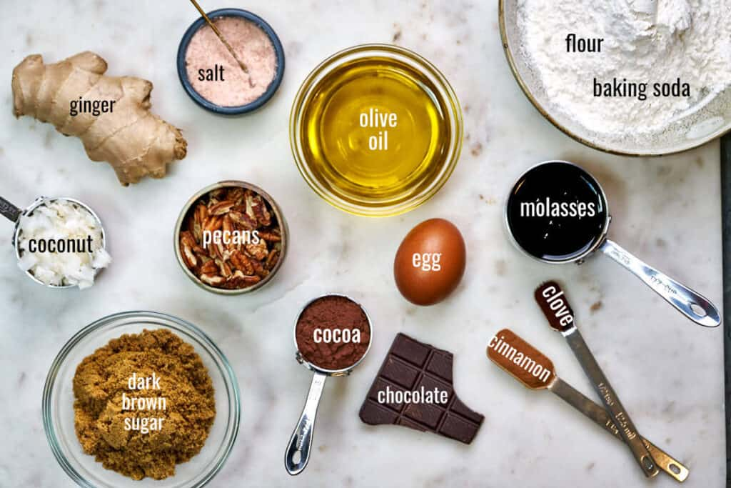 Labeled ingredients for chocolate ginger cake on a white countertop.