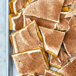 Top view of a sheet pan full of toffee.