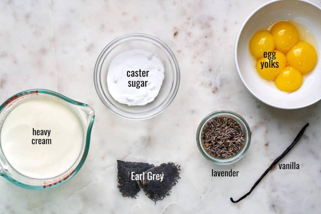 Ingredients for creme brulee including tea, cream, sugar, yolks, lavender, and vanilla.