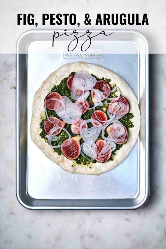Fig pizza on a baking sheet with title text.