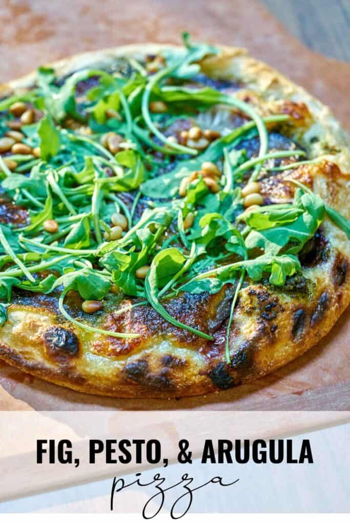 Pizza on a pizza peel with fresh arugula with title text.