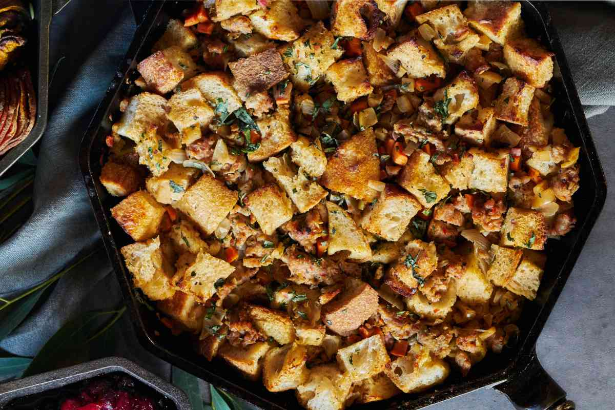 Cast iron pan with bread and sausage stuffing.