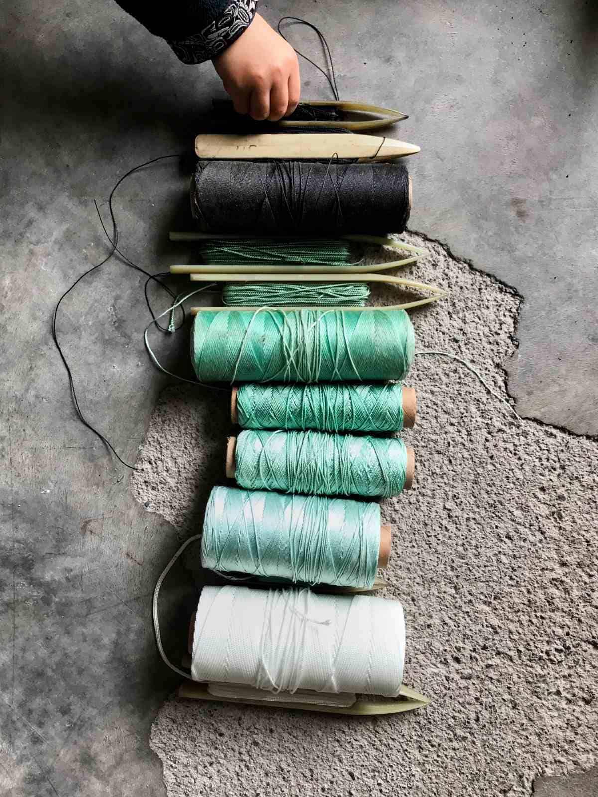 Spools of fishing net thread.