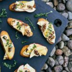Crostini on a cutting board.