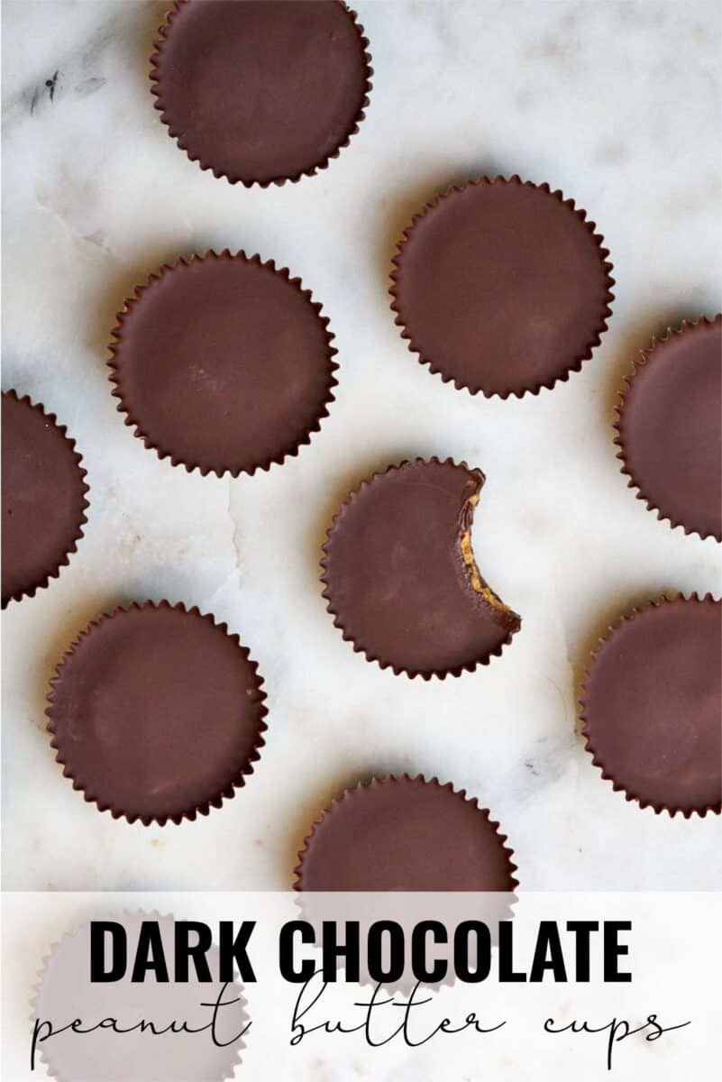 Peanut butter cups on a white countertop.