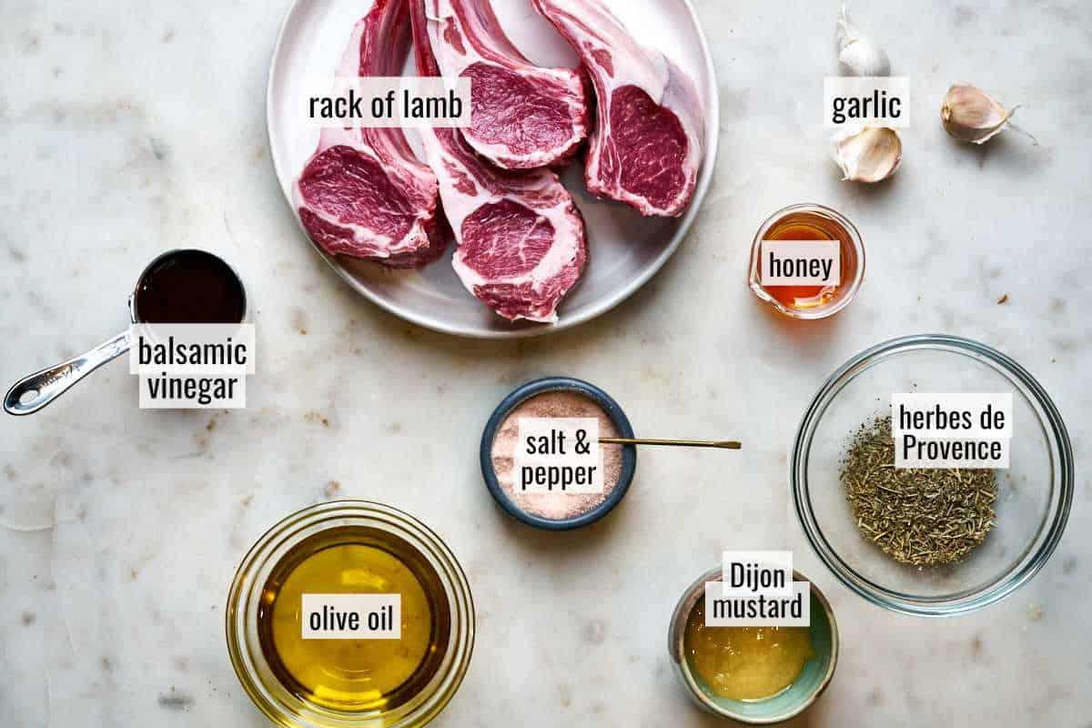 Rack of lamb ingredients on a marble countertop.