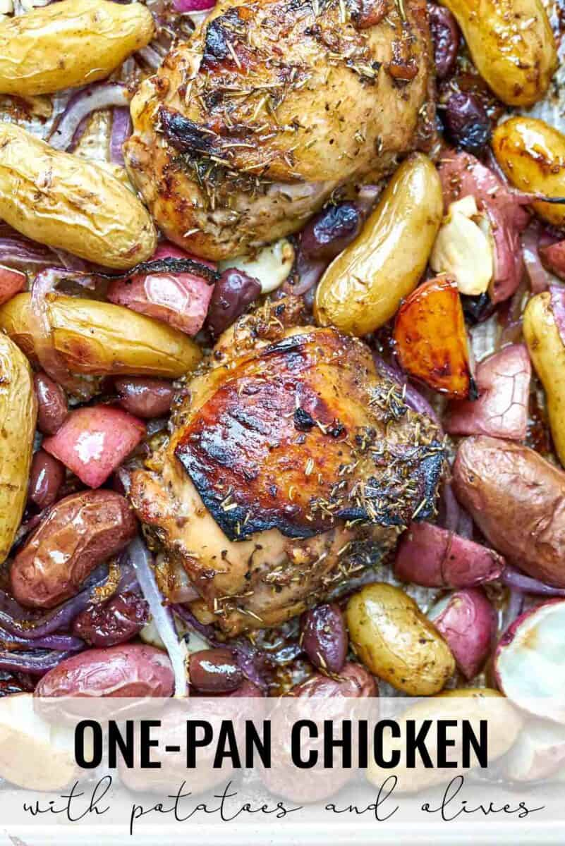 Cooked chicken and potatoes on a sheet pan.