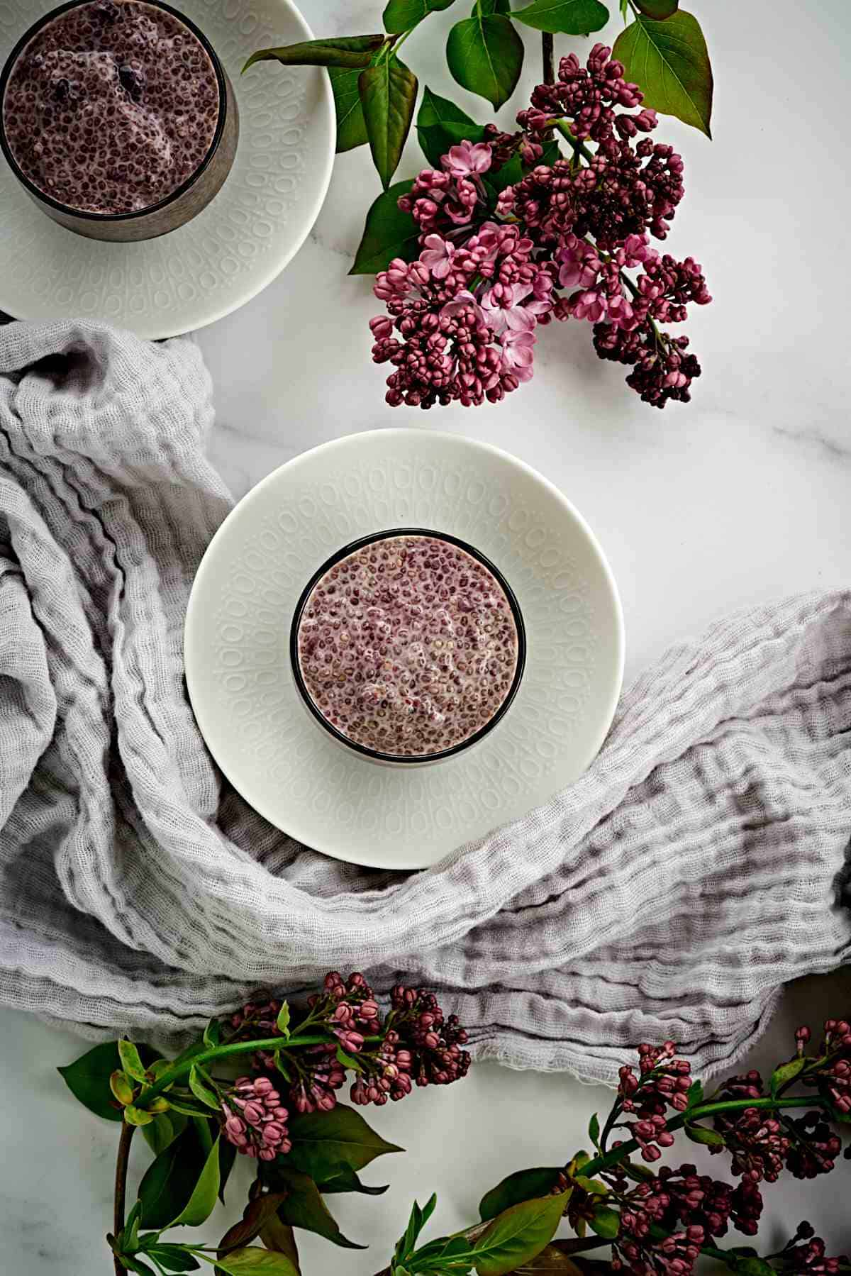 Chia pudding in a cup with flowers.