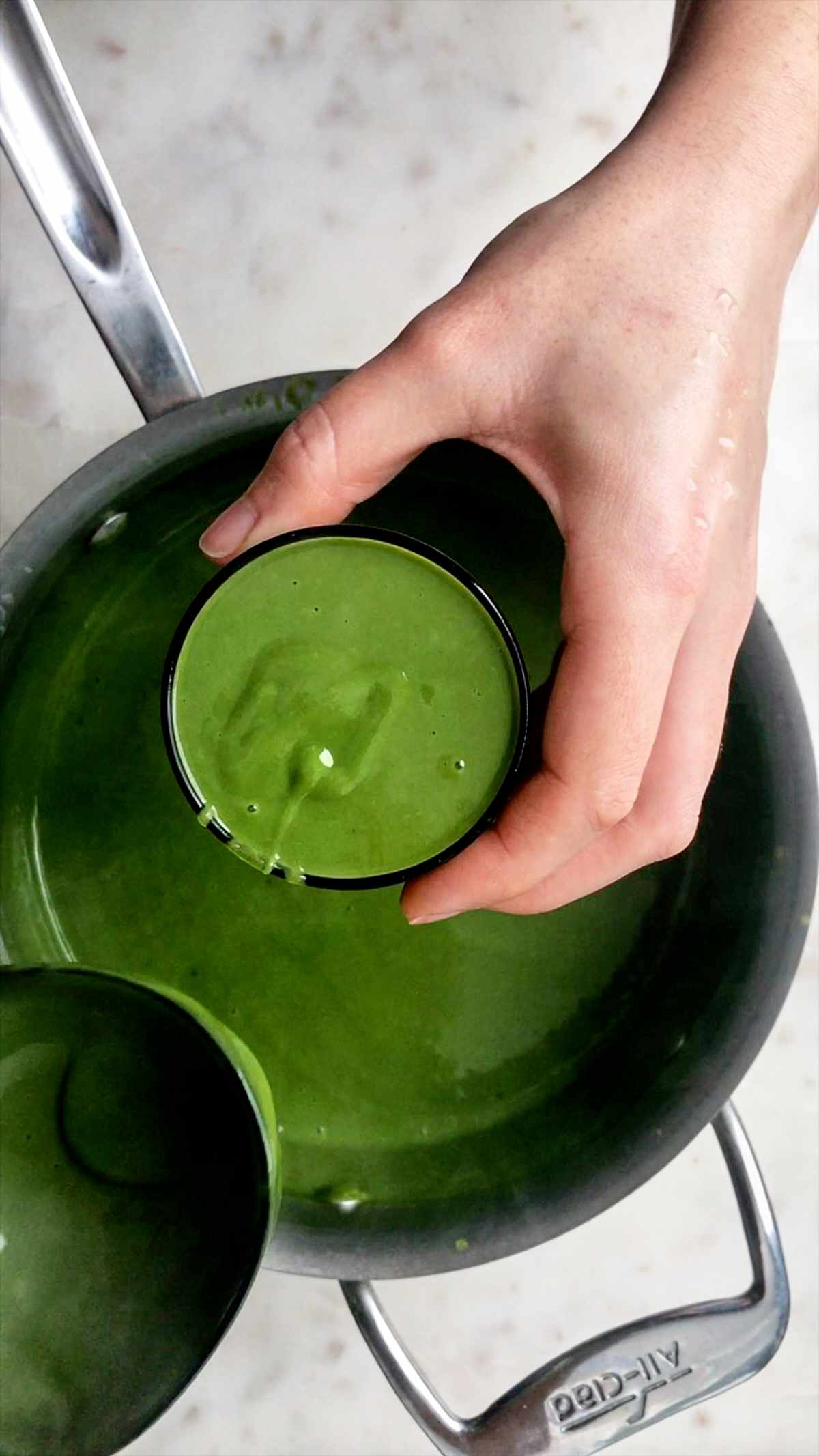 Cup full of warm green pudding.