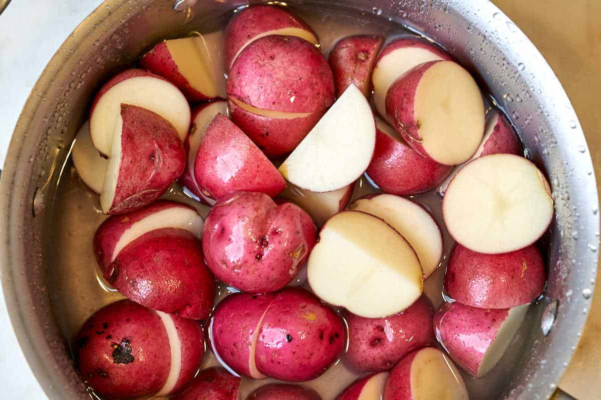 Red potatoes in a pot.