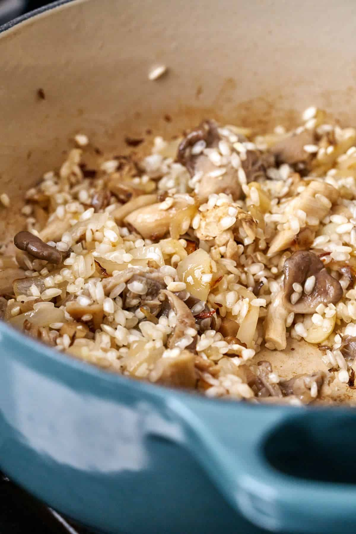 Rice and mushrooms in a pot.