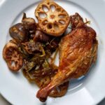 Crispy duck leg with vegetables.