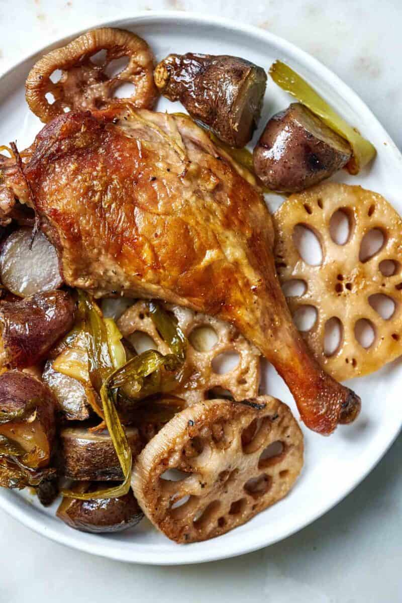 Crispy duck leg with vegetables.