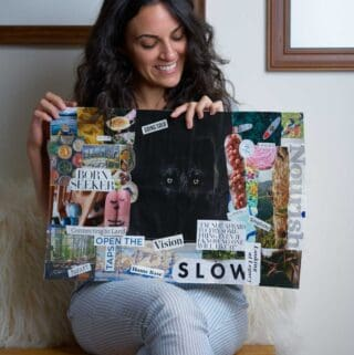 Woman holding a vision board.