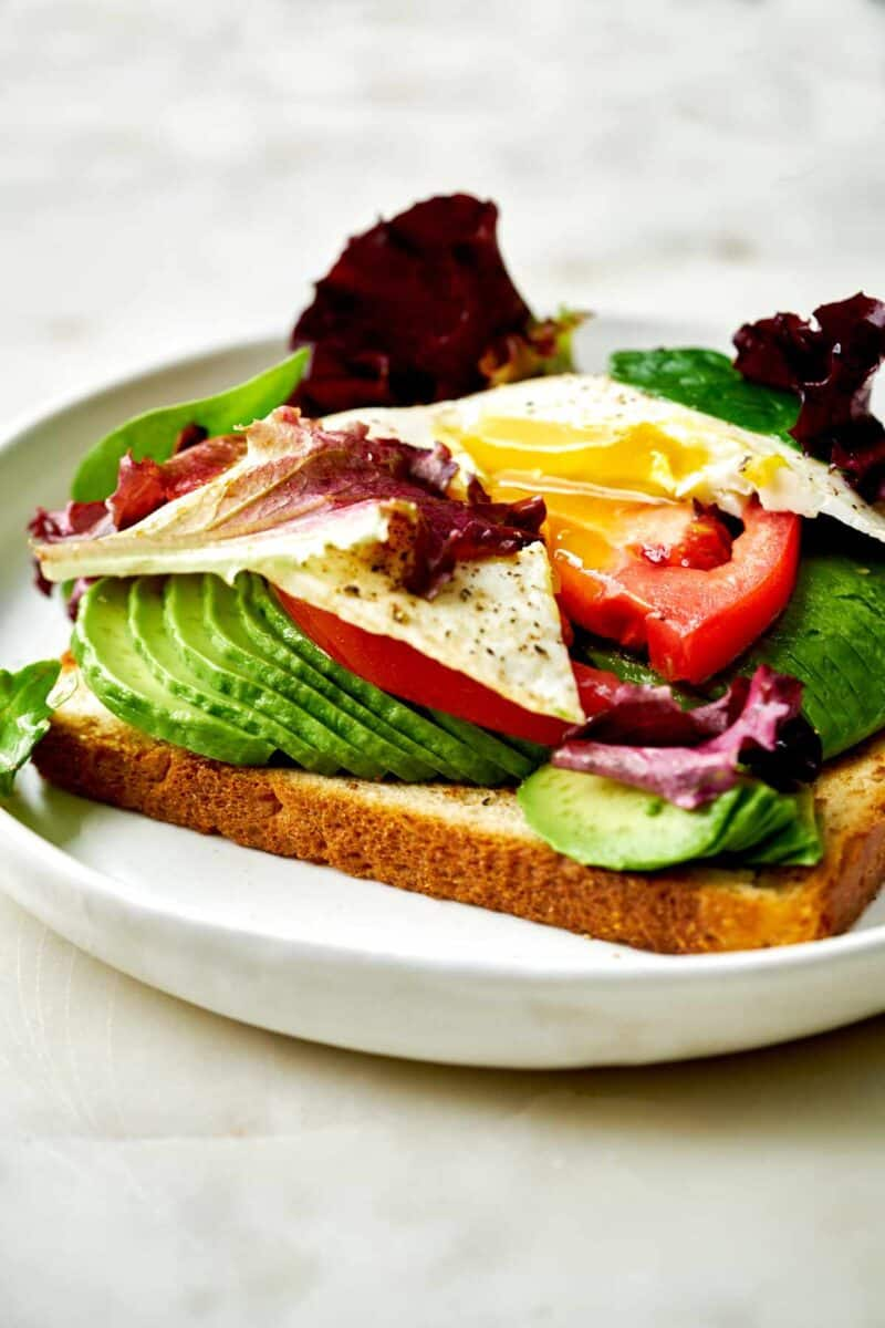 Toast with avocado, eggs, and lettuce.