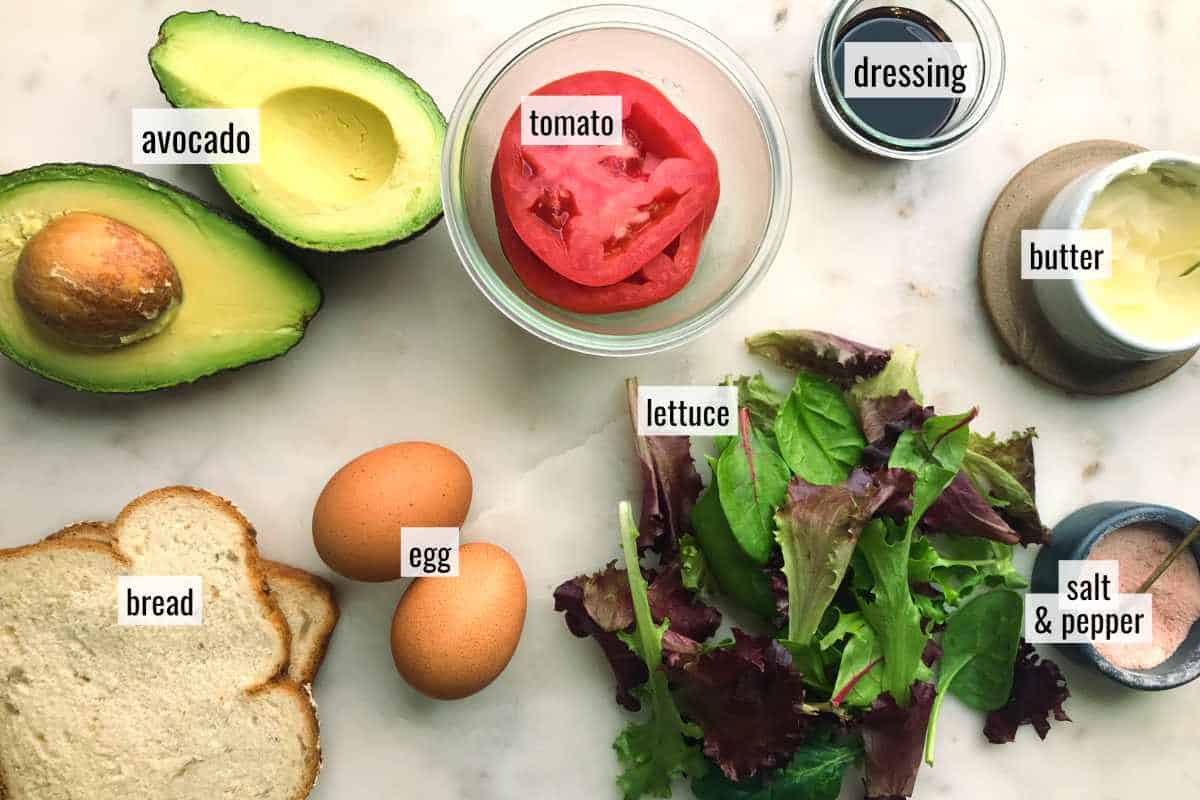 Ingredients for avocado toast on a countertop.