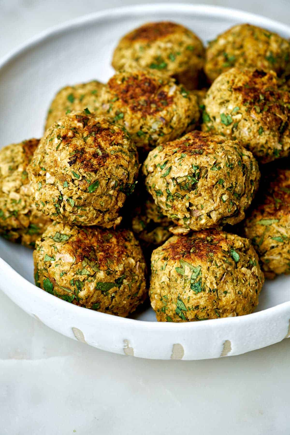 Dish filled with falafel.