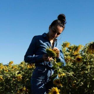 Woman in sunflower field.