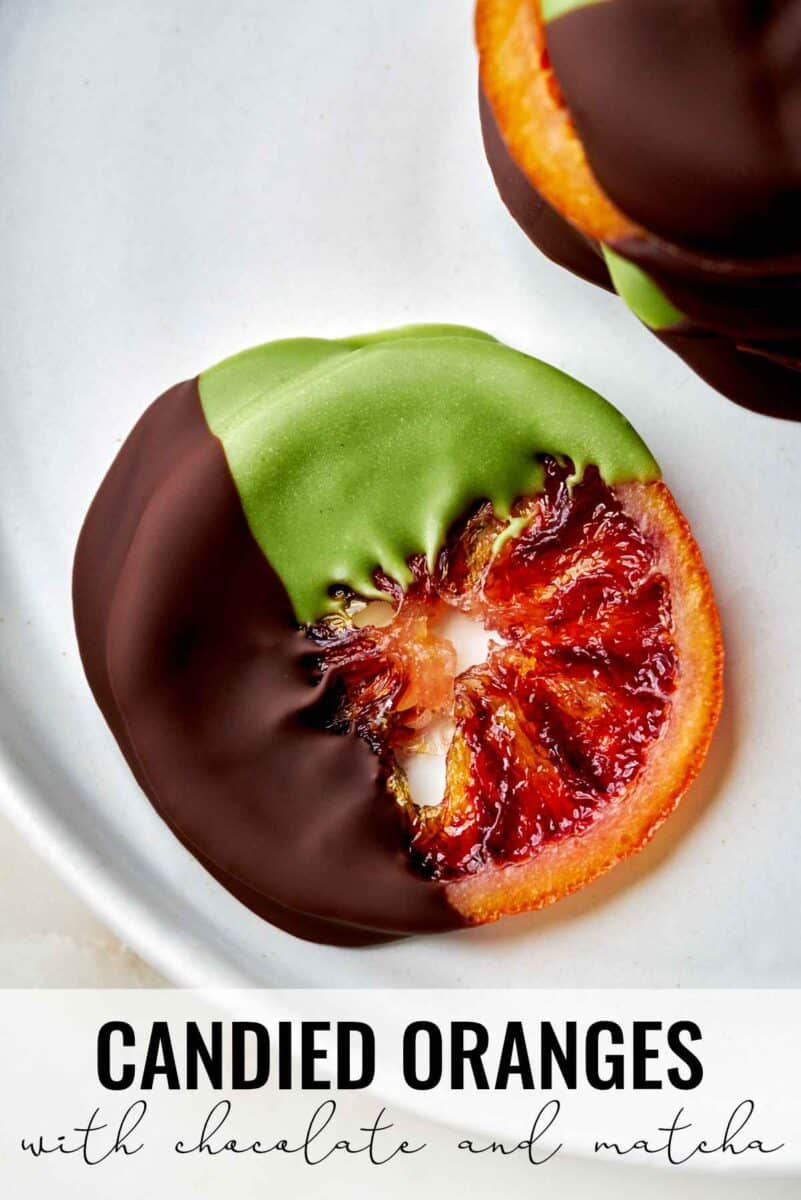 Orange slices dipped in chocolate and green chocolate.