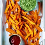 Sweet potato fries on a tray.