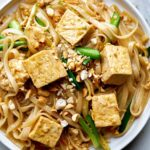 Plate with noodles and tofu.