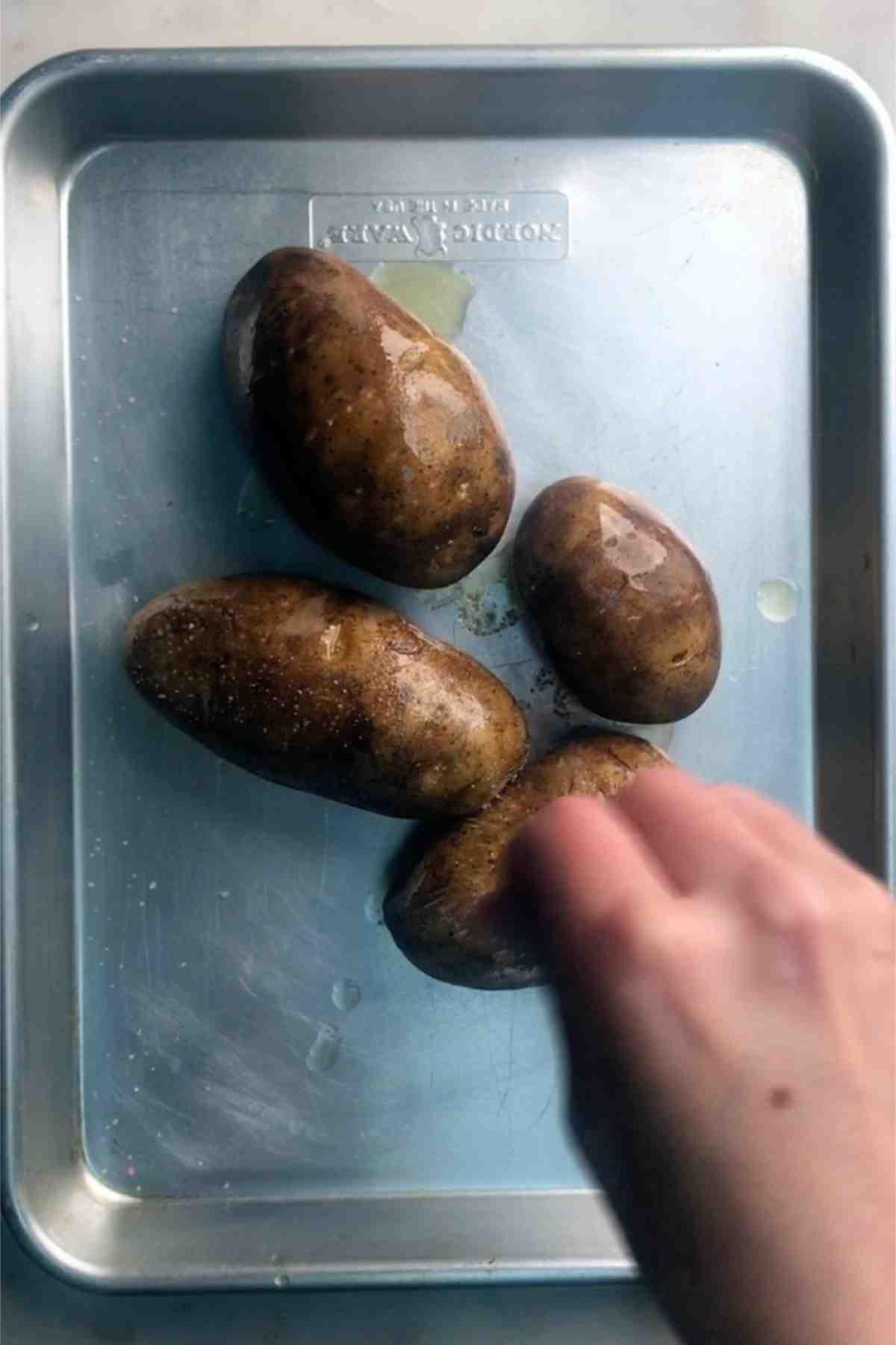 Potatoes on a baking sheet.