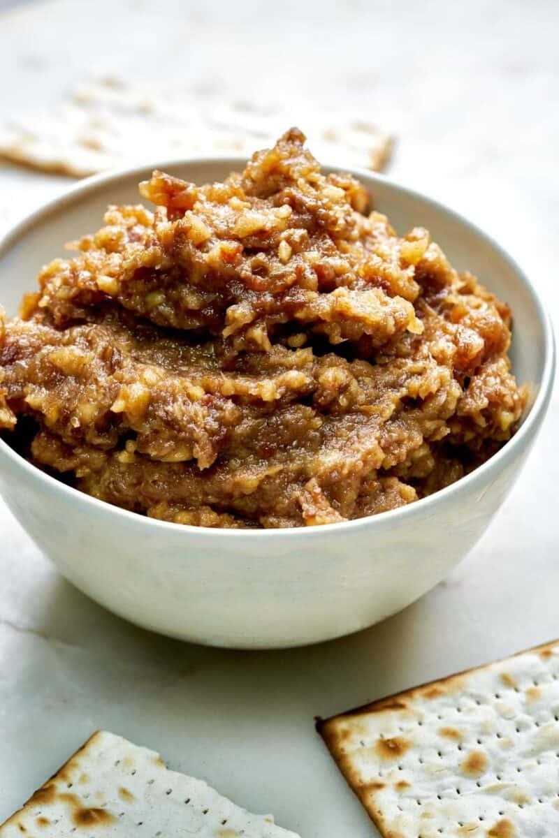 Bowl of brown dip with matzo.