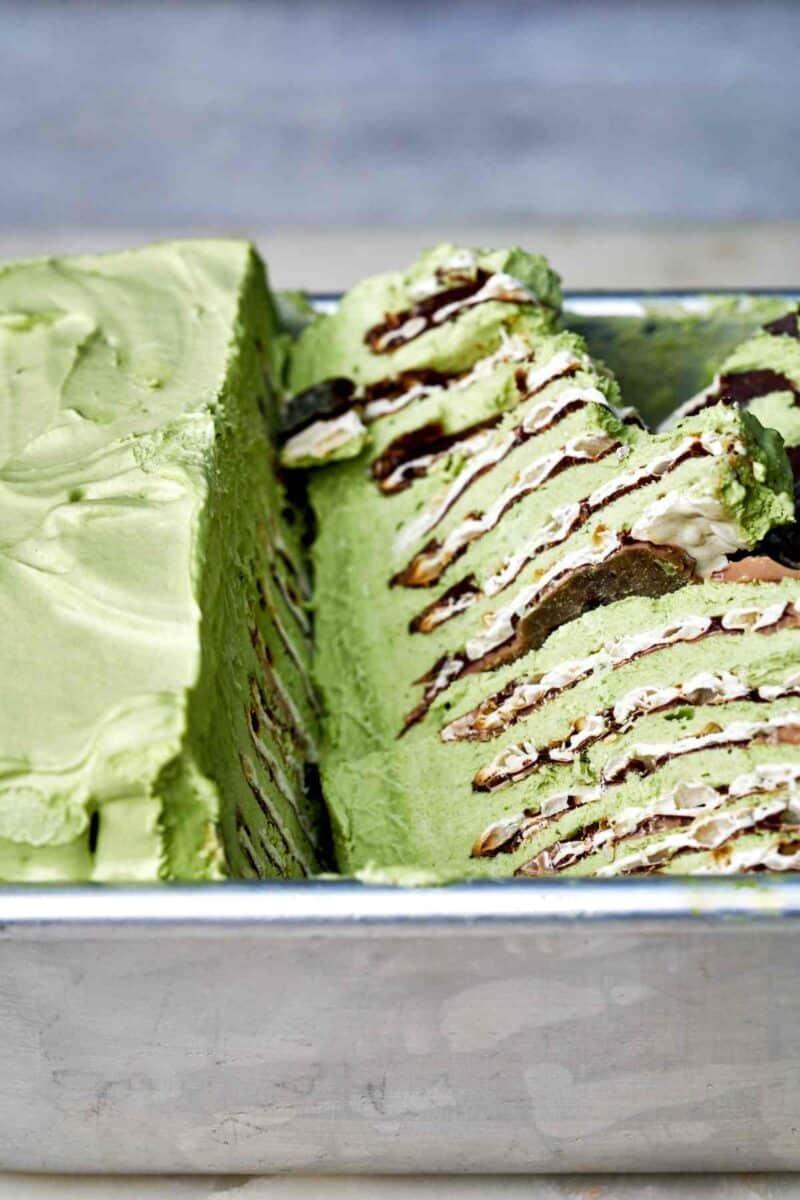 Green ice box cake in a tin.