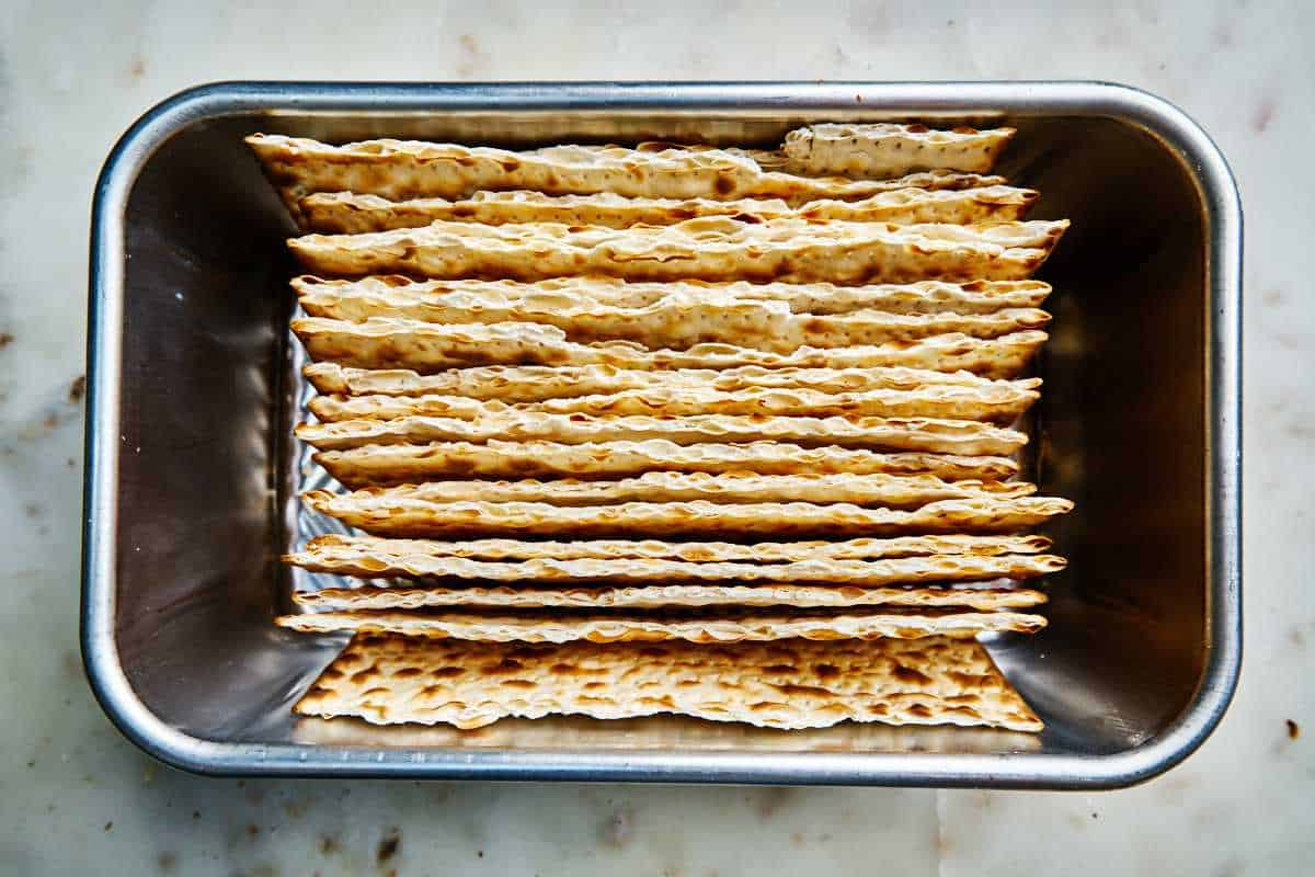 Matzo layered in a loaf pan.