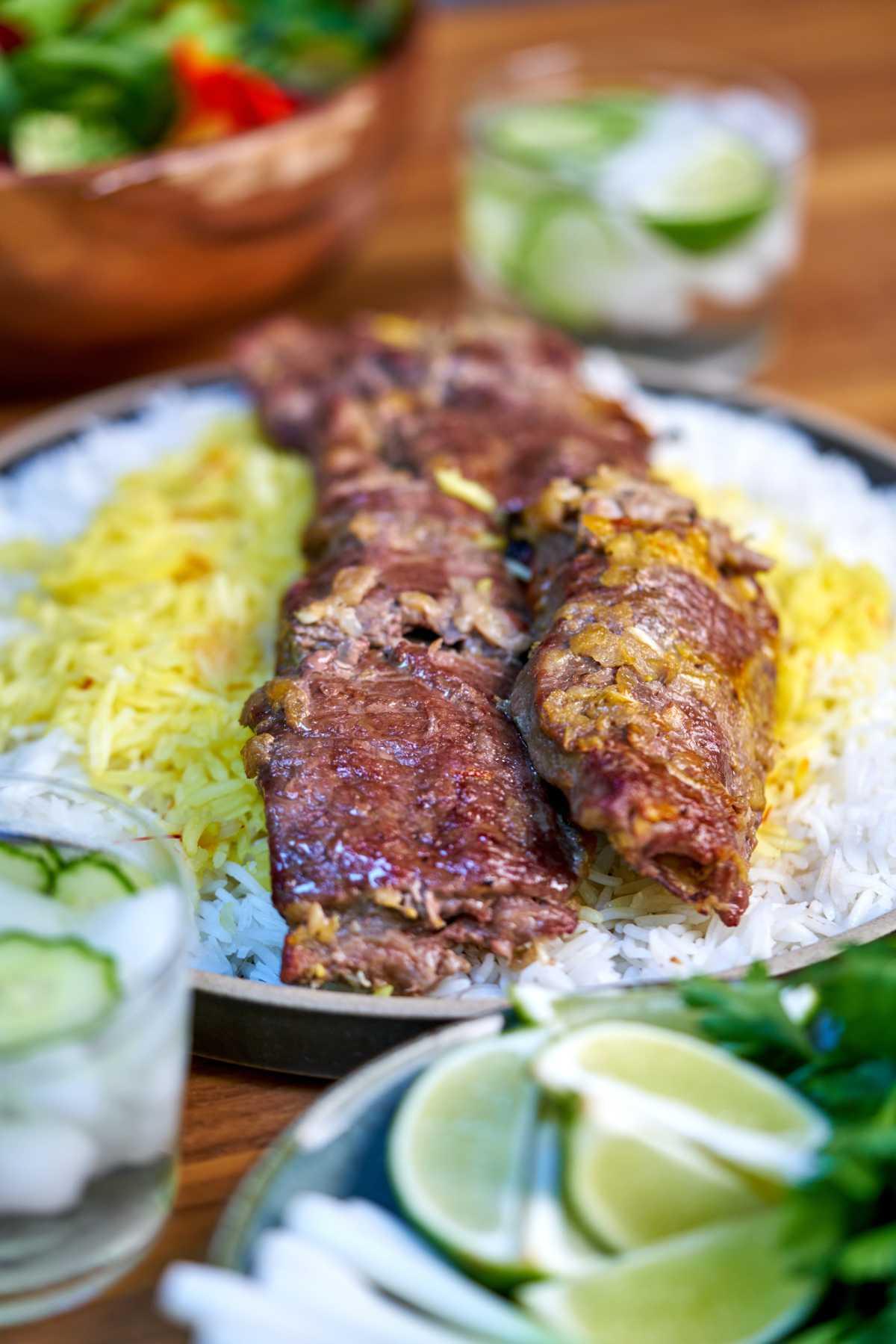 Kabob with rice and salad.
