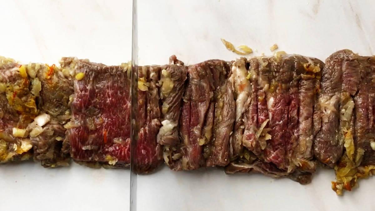 Knife tenderizing meat.