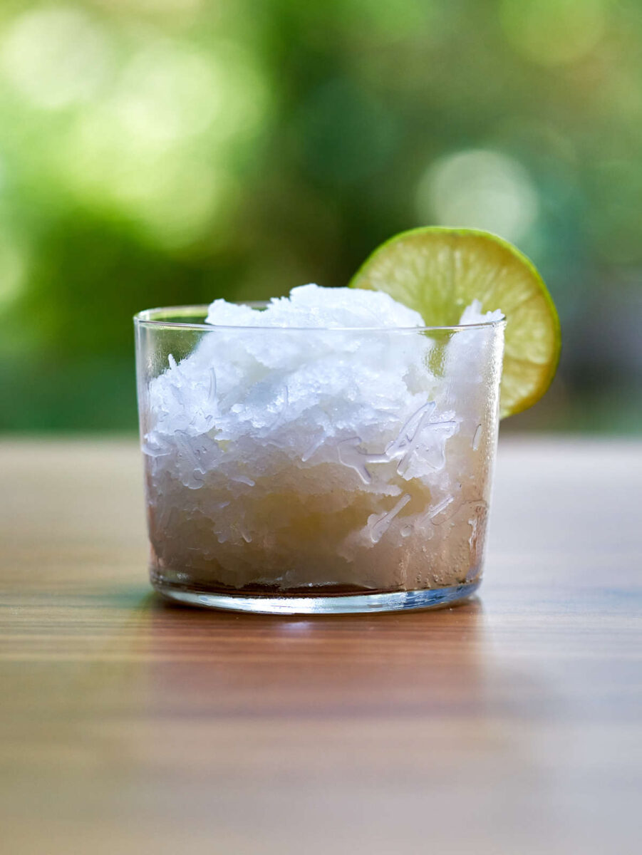 Glass with sorbet and lime.