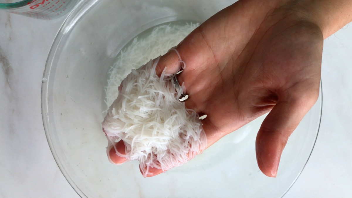 Rice noodles in a hand.
