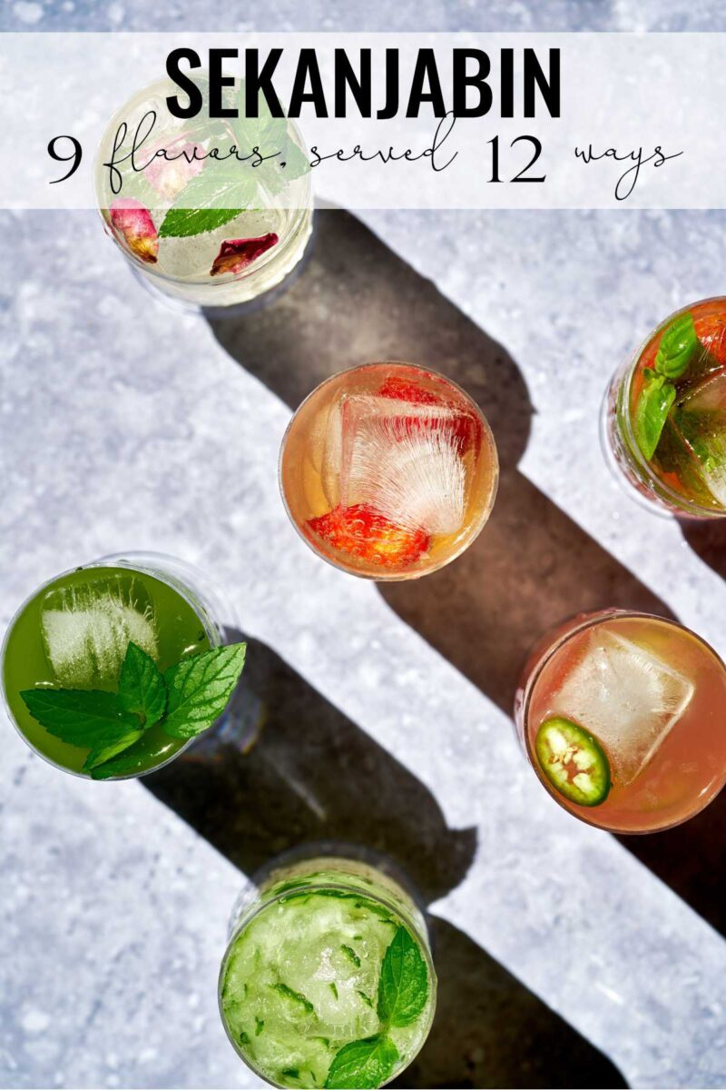 Glasses with different colored drinks.