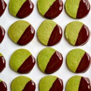 Green cookies dipped in chocolate.